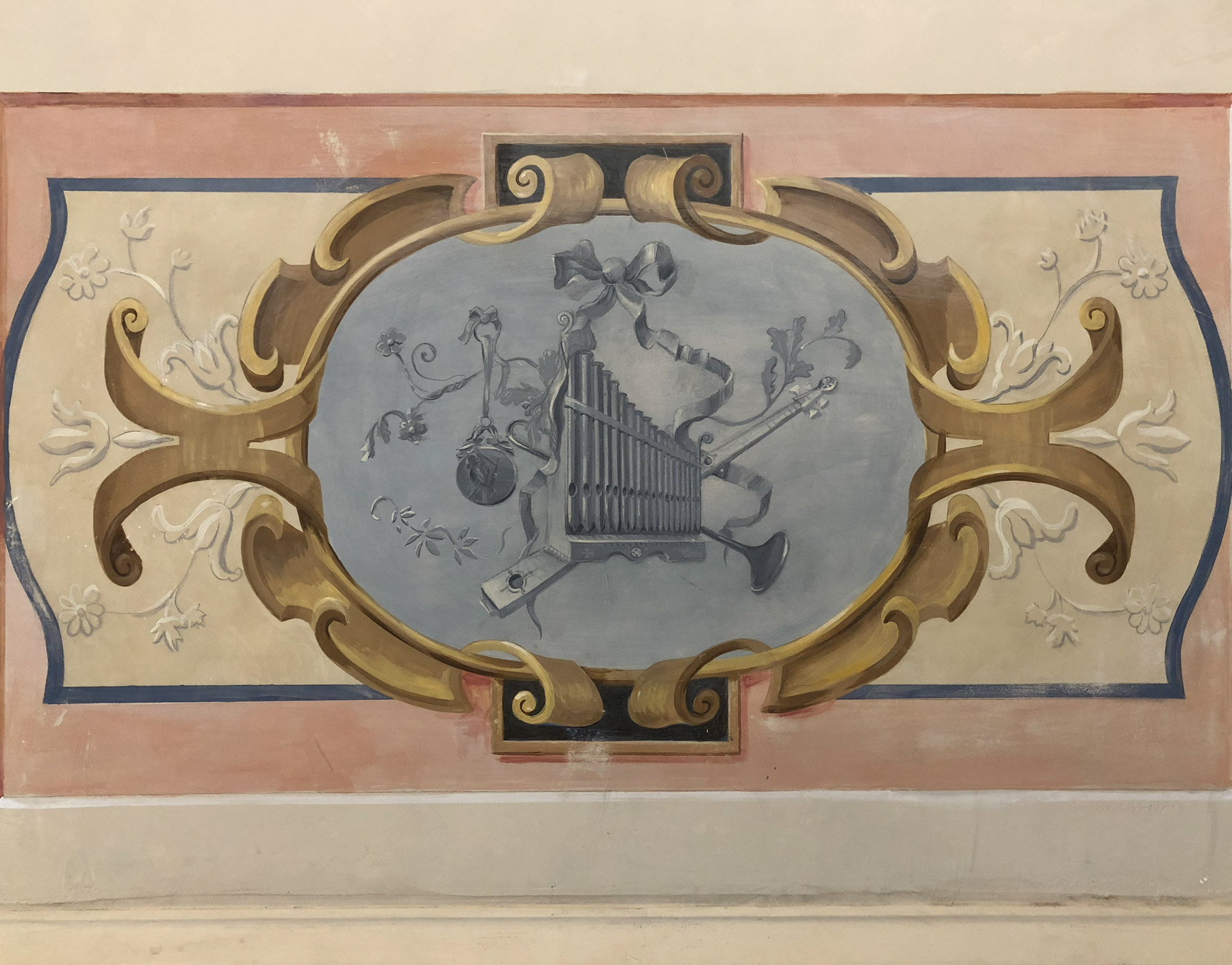 Mural detail with vignette of musical instruments
