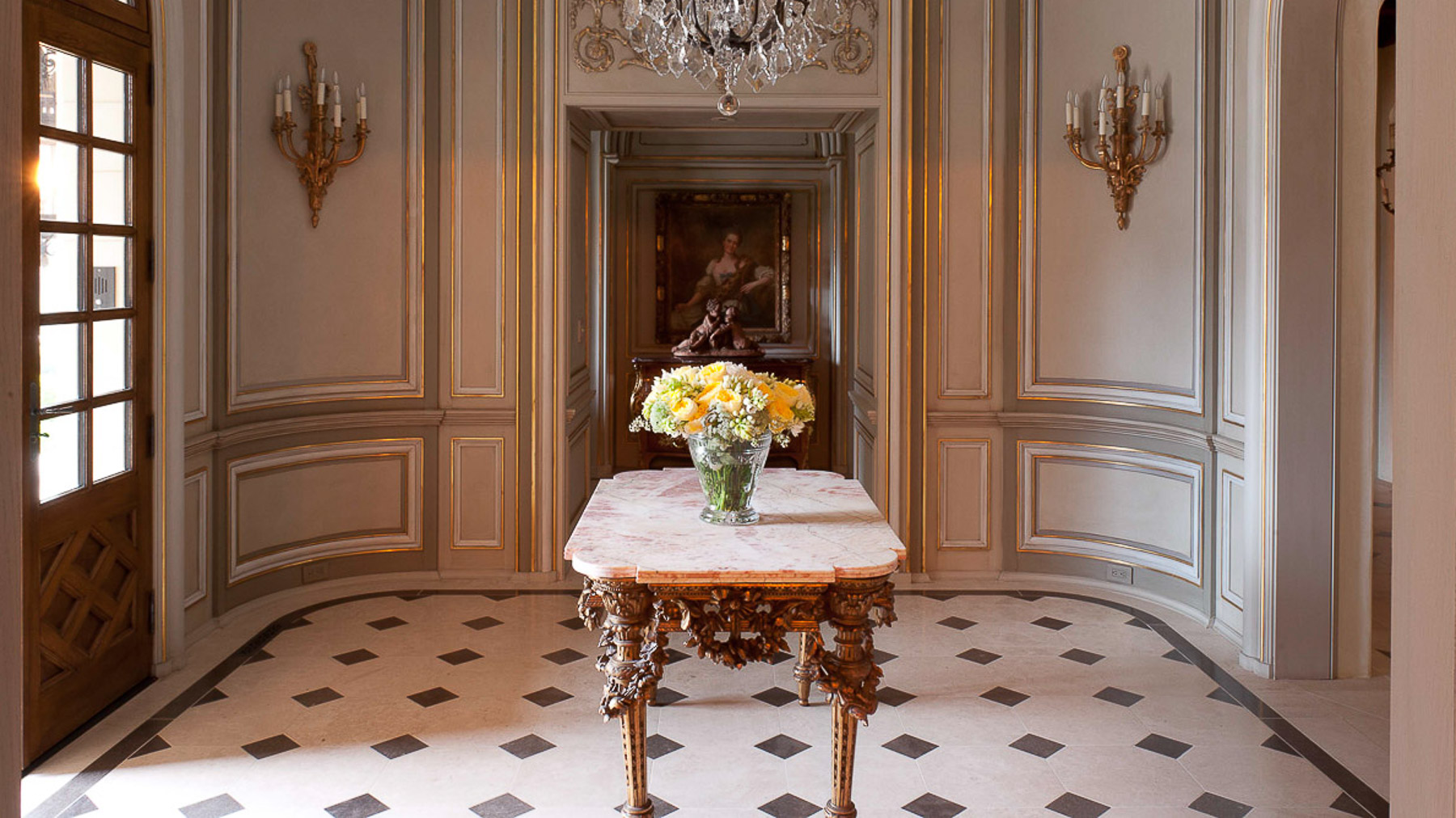Gilded detailing for wood panels for foyer room with marble floors