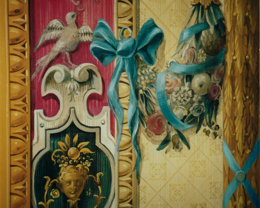 French tapestry mural detail of ribbons and birds on ornate background