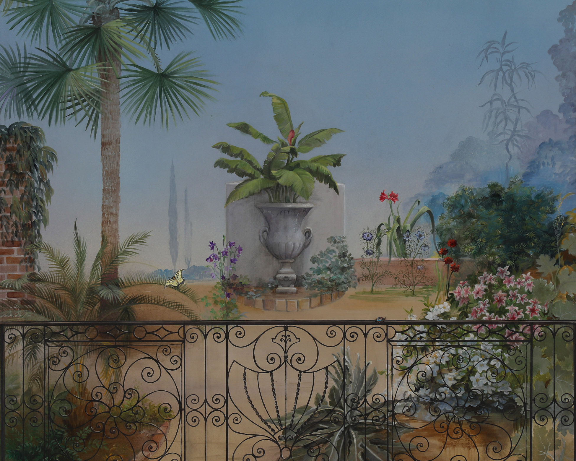 Low country mural with palms, flowers and wrought iron fence detail
