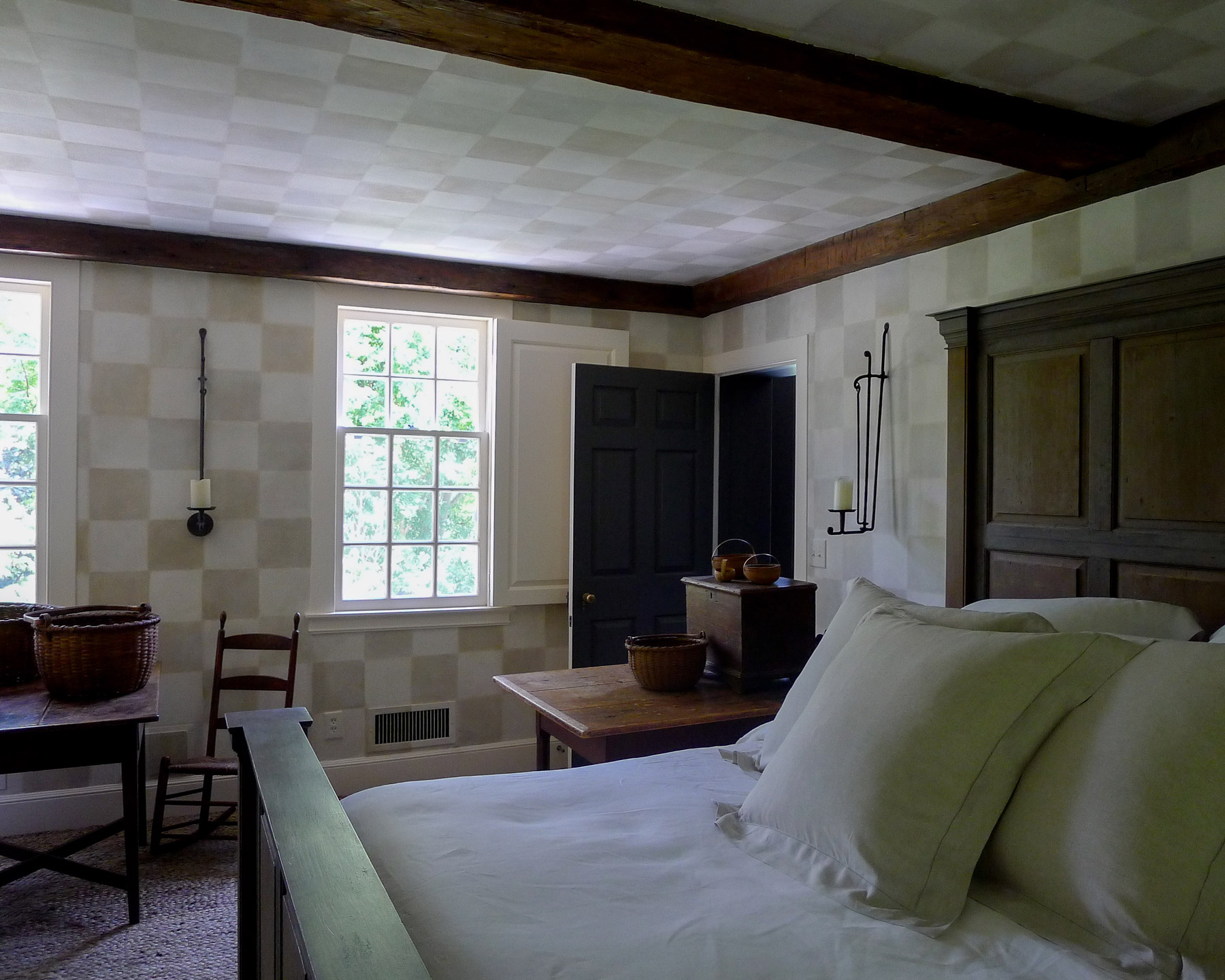Image of bedroom with handpainted walls featuring subtle grid of cream and beige