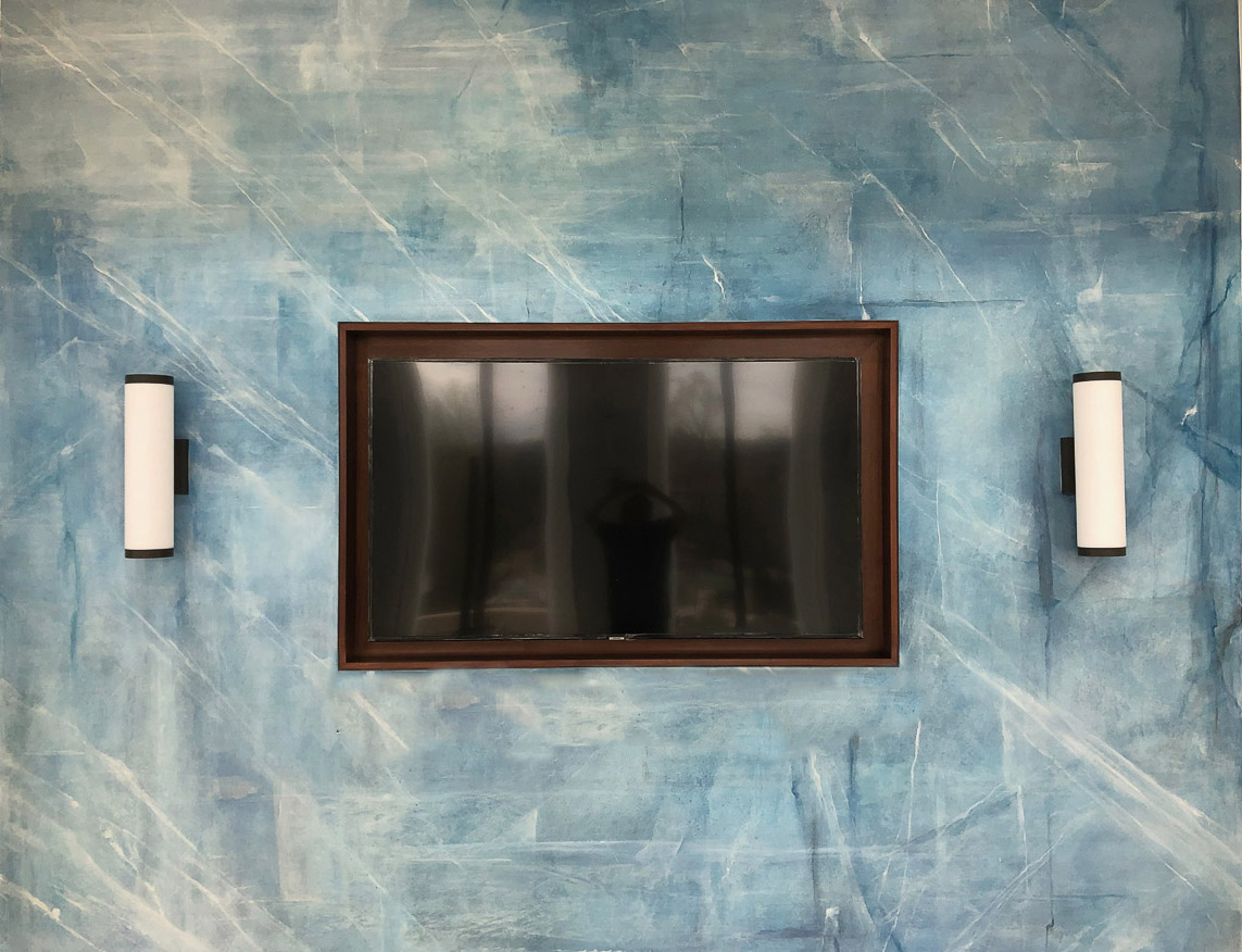 Custom wall painting in blue with white highlights