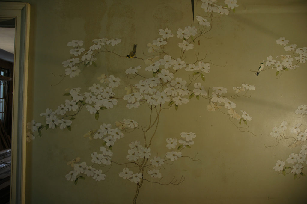 damaged wallpaper with flowering dogwood image