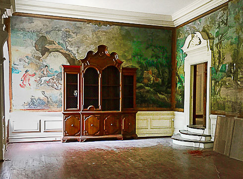 mural cover up by cabinet