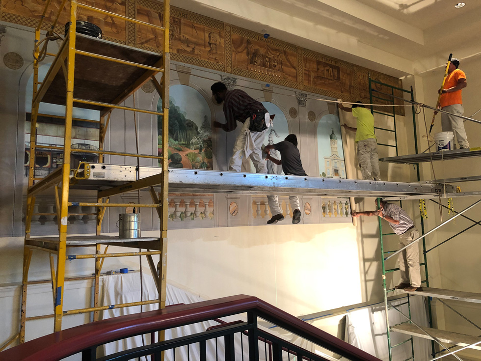 mural installation with workers on scaffolding at the Classic Center