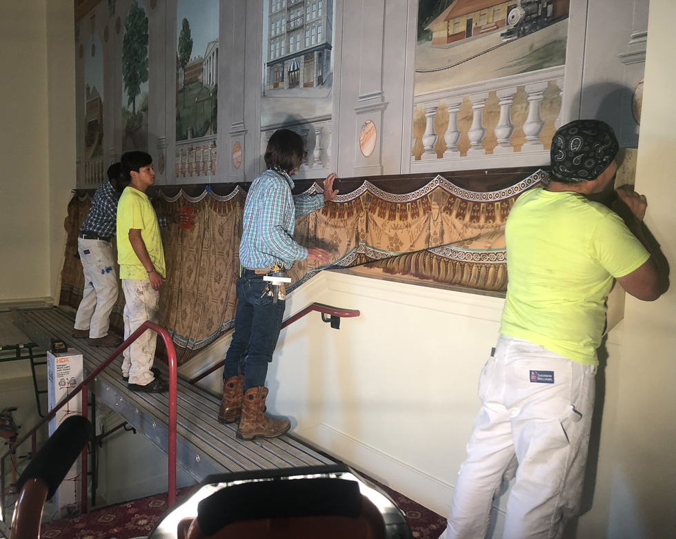 Mounting mural to wall at Classic Center